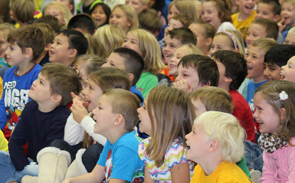 children engaged and laughing during the best environment show for schools